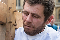 Westminster, London, March 25th 2016. Westminster's annual interdenominational Easter procession takes place with a procession from Methodist Central Hall to Westminster Cathedral and then on to Westminster Abbey, with the cross borne by people from The Passage, a homeless charity. PICTURED: A man from homeless charity The Passage carries the cross. <br /> ©Paul Davey<br /> FOR LICENCING CONTACT: Paul Davey +44 (0) 7966 016 296 paul@pauldaveycreative.co.uk