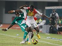Photo: Steve Bond/Richard Lane Photography.<br />Nigeria v Mali. Africa Cup of Nations. 25/01/2008. Amadou Sidibe (R) is harassed by Obinna Nwaneri (L)