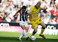 Photo: Rich Eaton.<br /> <br /> West Bromwich Albion v Leeds United. Coca Cola Championship. 30/09/2006. Jason Koumas left for West Brom shoots as Kevin Nicholls of Leeds defends