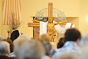 A crucifix with the risen Christ is pictured in the sanctuary of a Catholic church. (Sam Lucero photo)