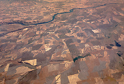 The land in eastern Washington along the Snake River appears to be dry in this photo taken at 1:12 p.m. on an Alaska Airlines flight from Seattle-Tacoma International Airport to St. Louis, Mo. At the time this photo was taken on July 31,2017 the state of Washington was experiencing very dry conditions. In Seattle, <br /> <br /> Seattle&rsquo;s record-breaking 55-day dry streak would later end on Aug. 12, when 0.02&Prime; of rain fell. This was the first time measurable precipitation was recorded in the city since June 17.