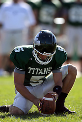 04 October 2008: Brien Rooney set the ball in place for the kicker on a point after attempt during a battle between the Carthage Red Men and the Illinois Wesleyan University Titans, Game action was at Wilder Field on the campus of Illinois Wesleyan University in Bloomington Illinois.