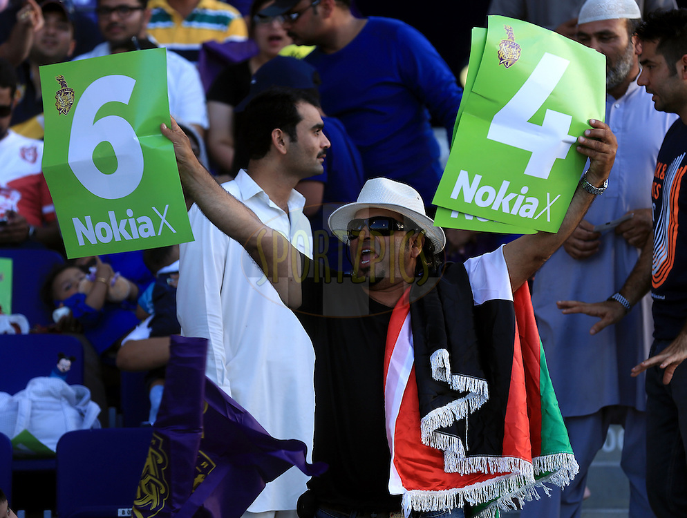 Fan's enjoys during match 15 of the Pepsi Indian Premier League 2014 Season between The Kings XI Punjab and the Kolkata Knight Riders held at the Sheikh Zayed Stadium, Abu Dhabi, United Arab Emirates on the 26th April 2014<br /> <br /> Photo by Sandeep Shetty / IPL / SPORTZPICS