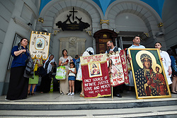 © Licensed to London News Pictures. 21/07/2019. LONDON, UK.  People prepare to take part in the Procession of Our Lady of Mount Carmel, starting at St Peter's Italian Church and then around the streets of Clerkenwell.  Floats carry life size depictions of Biblical scenes in a Catholic festival which has taken place annually for 100 years in the area which was once the capital's Little Italy.  Photo credit: Stephen Chung/LNP