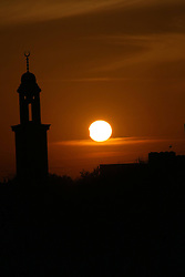 60670629<br /> Partial solar eclipse is seen in the West Bank City of Hebron, Sunday November 3 2013. Picture by  imago / i-Images.<br /> UK ONLY