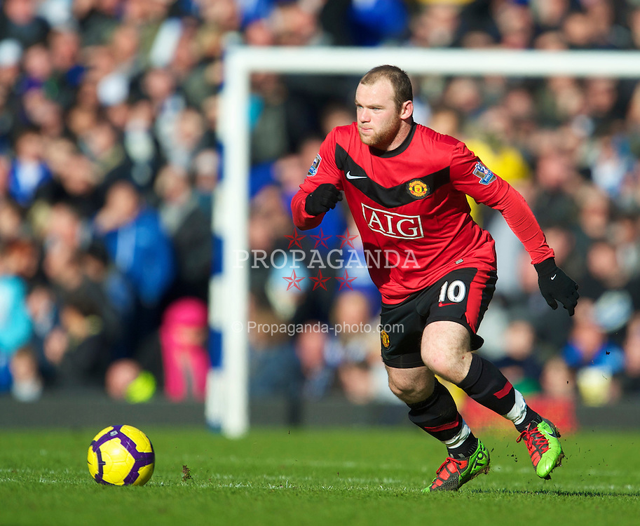 LIVERPOOL, ENGLAND - Saturday, February 20, 2010: Manchester United's Wayne Rooney in action against Everton during the Premiership match at Goodison Park. (Photo by: David Rawcliffe/Propaganda)