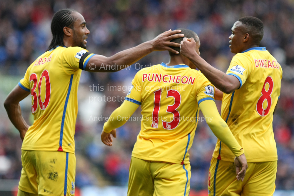 Jason Puncheon of Crystal Palace (13) celebrates after scoring his side's first goal with team-mates Cameron Jerome and Kagisho Dikgacoi. Barclays Premier league match, Cardiff city v Crystal Palace at the Cardiff city stadium in Cardiff, South Wales on Saturday 5th April 2014.<br /> pic by Mark Hawkins, Andrew Orchard sports photography.