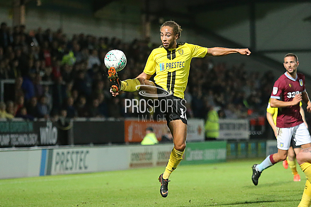 Burton Albion midfielder Marcus Harness (16) controls the ball during the second round or the Carabao EFL Cup match between Burton Albion and Aston Villa at the Pirelli Stadium, Burton upon Trent, England on 28 August 2018.