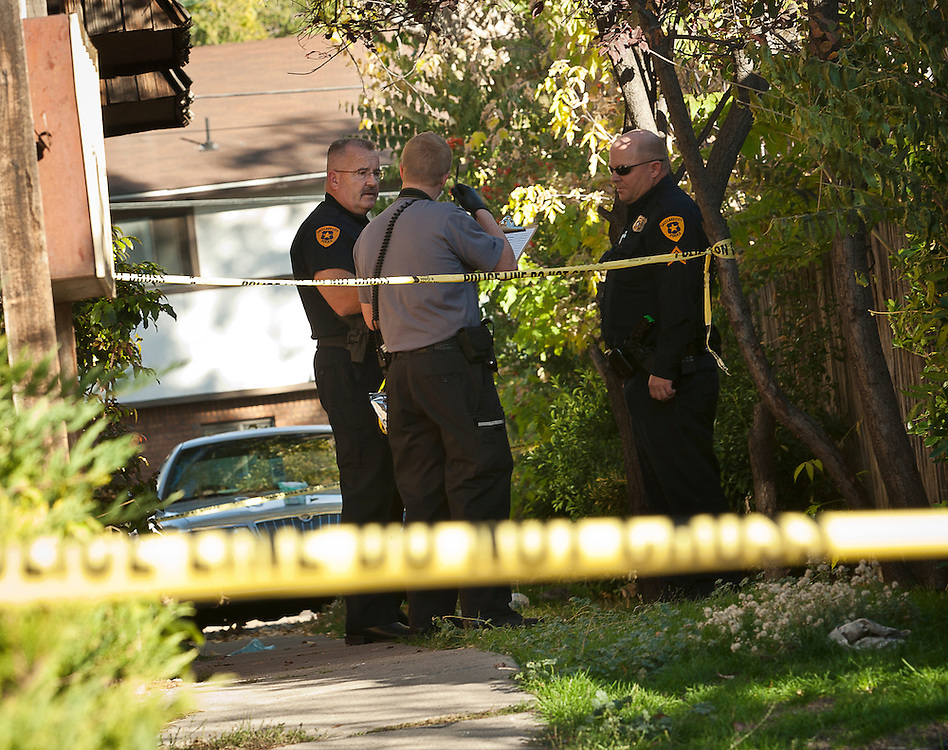 Salt Lake City Police Department officers stand outside following an armed home invasion shooting at 2300 Green Street in Salt Lake City, Tuesday, Oct. 30, 2012.