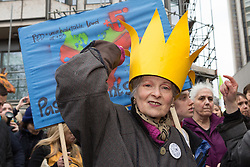 © Licensed to London News Pictures. 29/11/2015. London, UK. VIVIENNE WESTWOOD joins protesters to take part in the People's March for Climate, Justice and Jobs in central London. Marchers are calling for world leaders take further measures to combat climate change and environmental issues. Demonstrations are taking place around the globe today to demand United Nations action against climate change, calling on world leaders to cease political posturing and commit to a concrete international plan for people affected by climate change at the UN Paris Climate Change Summit. Photo credit : Vickie Flores/LNP