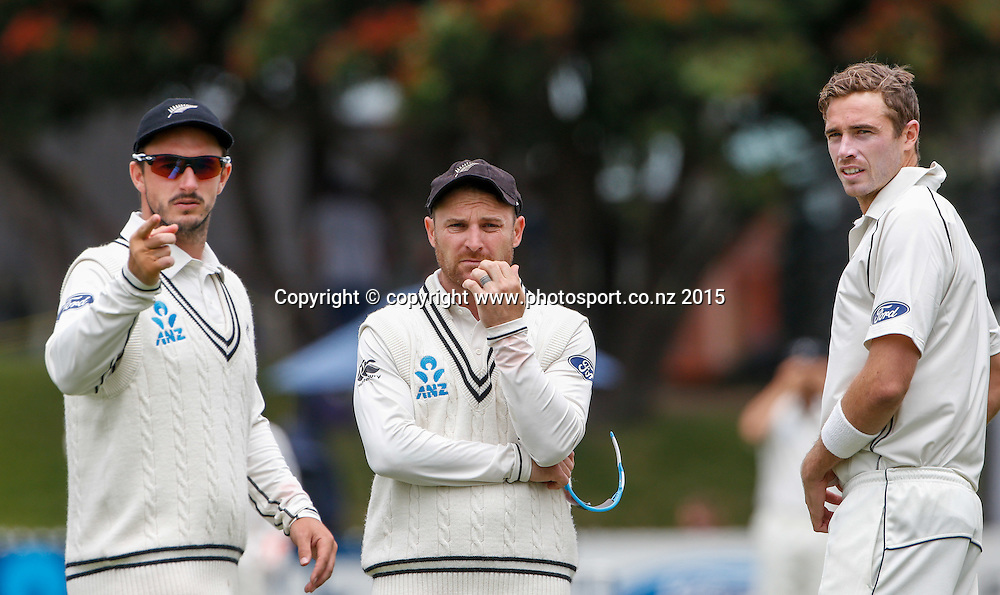 Hamish Rutherford, Brendon McCullum and Tim Southee discuss field palcements. Fifth day, second test, ANZ Cricket Test series, New Zealand Black Caps v Sri Lanka, 07 January 2015, Basin Reserve, Wellington, New Zealand. Photo: John Cowpland / www.photosport.co.nz