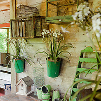 Rustic Cabin: Vintage table and cages on porch