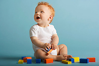 Redheaded Baby Playing With Blocks