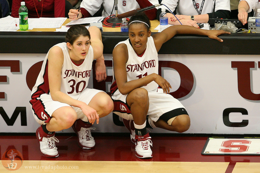 February 4, 2007; Stanford, CA, USA; Stanford Cardinal forward Brooke Smith (30, left) and guard Candice Wiggins (11, right) during the game against the California Golden Bears at Maples Pavilion. The Golden Bears defeated the Cardinal 72-57.