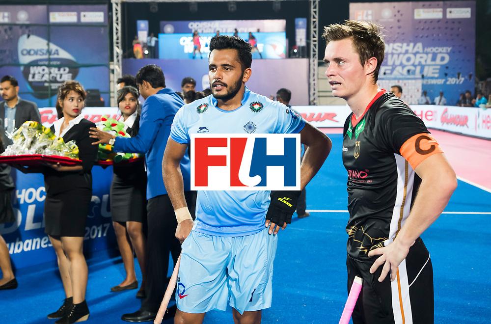 BHUBANESWAR - Hockey World League finals Match for bronze , Germany v India (1-2). Mats Grambusch (Ger) with  Harmanpreet Singh (Ind) . COPYRIGHT KOEN SUYK