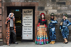 Spectacular costumes from a classic children&rsquo;s book, a sci-fi ballet and the Mexican underworld are showcased by University of Edinburgh students. <br /> <br /> The outfits have been designed by Performance Costume students for a jaw-dropping theatrical show. The Performance Costume Show takes place in Edinburgh College of Art&rsquo;s Sculpture Court on 18 and 19 May.<br /> <br /> Children&rsquo;s book favourite The Tiger Who Came to Tea is brought to life by student Gracie Martin&rsquo;s art deco design. She has imagined the tiger as a 1920s gangster wearing a pinstripe suit and tie.<br /> <br /> Yan Smiley has created characters for a sci-fi ballet set in 17th century Scotland. The outfit is inspired by stained glass windows and rugged Highland landscapes.<br /> <br /> Ellie Finch has made a dazzling outfit for Maid Marian, set in contemporary Mexico. The vibrant outfit highlights iconography linked to the country&rsquo;s drug cartels, with a headdress of poppies and needles and a kaleidoscopic skirt covered in prints of machine guns and cannabis leaves. <br /> <br /> Irvine Welsh&rsquo;s novel Marabou Stork Nightmares was the focus of Dayna Ali&rsquo;s surreal designs. She has created the Marabou Stork &ndash; half bird, half football hooligan. He has a large head and beak and wears fluorescent &lsquo;90s sportswear with a specially made Marabou logo.<br /> <br /> Zoe Frewin has created costumes from Disney Pixar&rsquo;s animation, A Bug&rsquo;s Life. Inspired by George Orwell&rsquo;s 1984, the insects wear uniforms and their colour denotes their class in society.<br /> <br /> Pictured: Josef Stitts wearing costume from The Tiger That Came for Tea designed by Gracie Martin, Gracie Martin wearing Maid Marion costume designed by Ellie Finch and Rachael Weir and Maddie Williams wearing Bugs Life costumes designed by Zoe Frewin