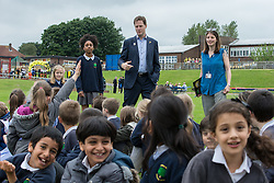 © Licensed to London News Pictures . 03/07/2014 . Leeds , UK . The Deputy Prime Minister , NICK CLEGG MP , at Ireland Wood Primary School in Leeds today (Thursday 3rd July 2014) shown around by pupil Lashay Henry-Welsh (11) from Yeadon in Leeds (left) . The Liberal Democrat leader and MP for Sheffield Hallam watches a Grand Depart school event with children taking part in cycling time trials and singing the the Tour de France anthem . Photo credit : Joel Goodman/LNP