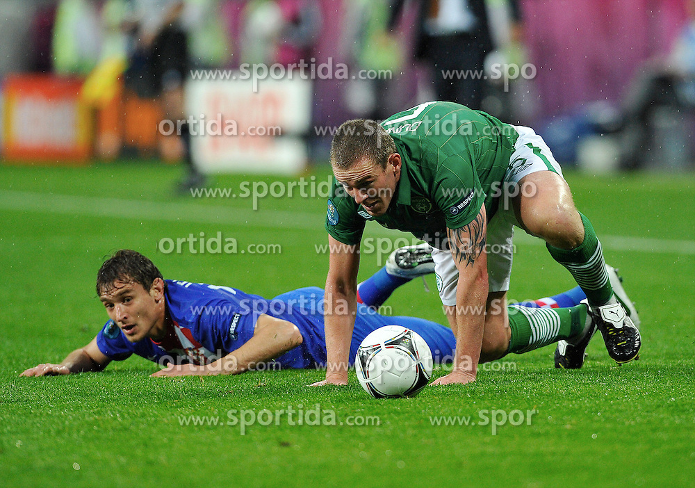 Poznan 10/06/2012.POLAND, Poznan.Nikica Jelavic of Croatia fights for the ball with Richard Dunne of Ireland during the Euro 2012 football championships match Croatia vs Ireland on June 10, 2012 during the Euro 2012 football championships .Photo by: Piotr Hawalej / WROFOTO