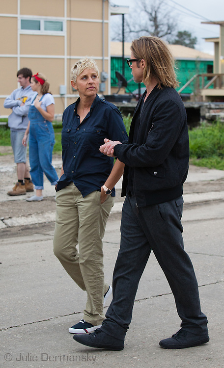 "Brad Pitt on a walking with   Ellen DeGeneres  on a tour through the "" Make it Right "" housing project in the Lower 9th Ward of New Orleans the day before a star-studded fundraising dinner  being held in New Orleans for his foundation."
