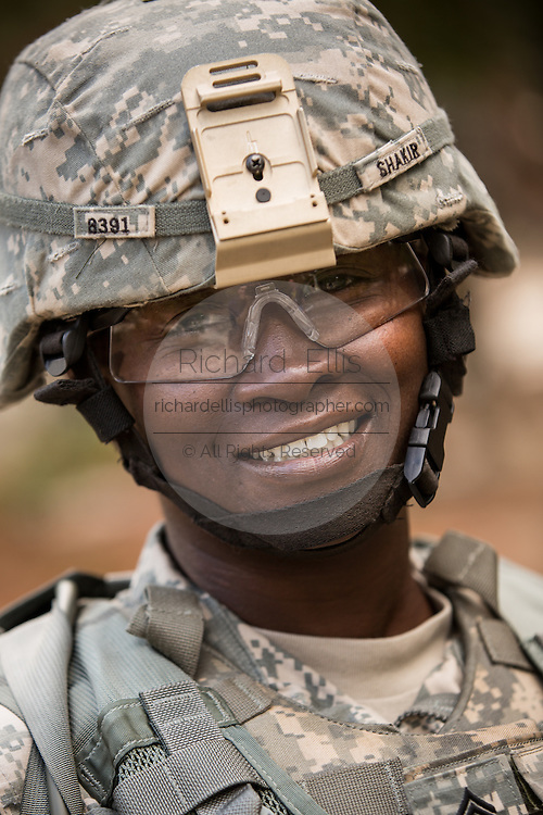 A woman Drill Sergeant smiles as she observes her recruits during basic combat training at Fort Jackson September 27, 2013 in Columbia, SC. While 14 percent of the Army is women soldiers there is a shortage of female Drill Sergeants.