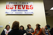 Mayor Jose Esteves supporters socialize during the Mayor Jose Esteves party in Milpitas, California, on November 4, 2014. (Stan Olszewski/SOSKIphoto)