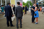 © London News Pictures. 20/06/2013. Ascot, UK. A couple kiss.  Ladies Day on day three of Royal Ascot at Ascot racecourse in Berkshire, on June 20, 2013. The 5 day showcase event, which is one of the highlights of the racing calendar, has been held at the famous Berkshire course since 1711 and tradition is a hallmark of the meeting. Top hats and tails remain compulsory in parts of the course.  Photo credit : Stephen Simpson/LNP