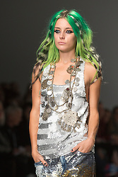 © Licensed to London News Pictures. 14/09/2013. London, England. A model walks the catwalk at the Ashish show during London Fashion Week. Photo credit: Bettina Strenske/LNP