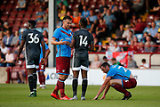 Andy Butler Of Scunthorpe United and Kelechi Iheanacho of Leicester City during the Pre-Season Friendly match between Scunthorpe United and Leicester City at Glanford Park, Scunthorpe, England on 16 July 2019.