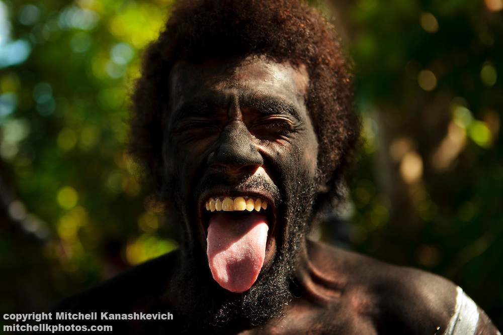 A snake dance performer making a face as he has make up applied in preparation for the snake dance. The snake dance is a traditional dance which takes place on special occations for the inhabitabts of Rah Lava Island. These days it is often performed for the visiting tourists. Rah Lava Island, Torba Province, Vanuatu