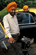 Sikh taxi drivers with their Ambassador cars, Delhi