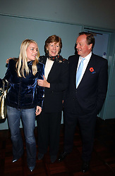 Left to right, LAURA PARKER BOWLES, her father ANDREW PARKER BOWLES and his wife ROSEMARY PARKER BOWLES at a party to celebrate the publication of 'E is for Eating' by Tom Parker Bowles held at Kensington Place, 201 Kensington Church Street, London W8 on 3rd November 2004.<br />
