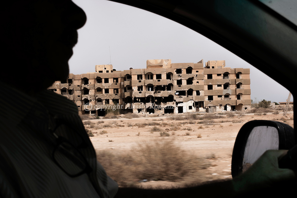 Libya: Destroyed building during the 2011 Libyan war on the road between Abu Grein and Sirte. Alessio Romenzi
