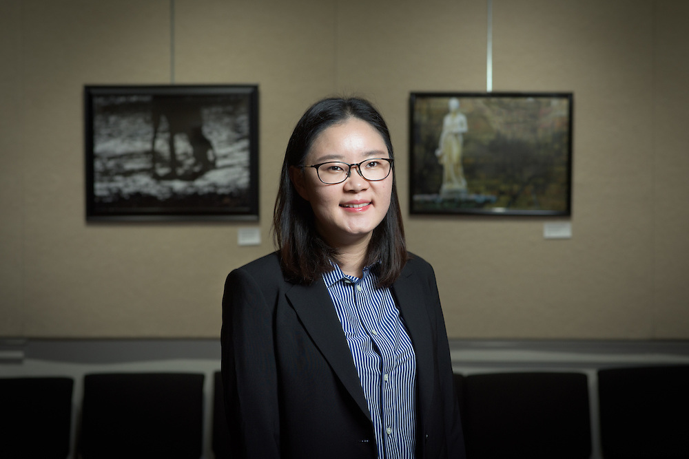 Rebecca Choi, an Assistant Professor of Restaurant and Hotel Tourism at Ohio University, poses for a portrait in Arts West in Athens, Ohio on February 21, 2017. Choi teaches students the process of event planning for her Hotel and Tourism course.
