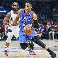 21 December 2015: Oklahoma City Thunder guard Russell Westbrook (0) drives past Los Angeles Clippers guard Chris Paul (3) during the Oklahoma City Thunder 100-99 victory over the Los Angeles Clippers, at the Staples Center, Los Angeles, California, USA.