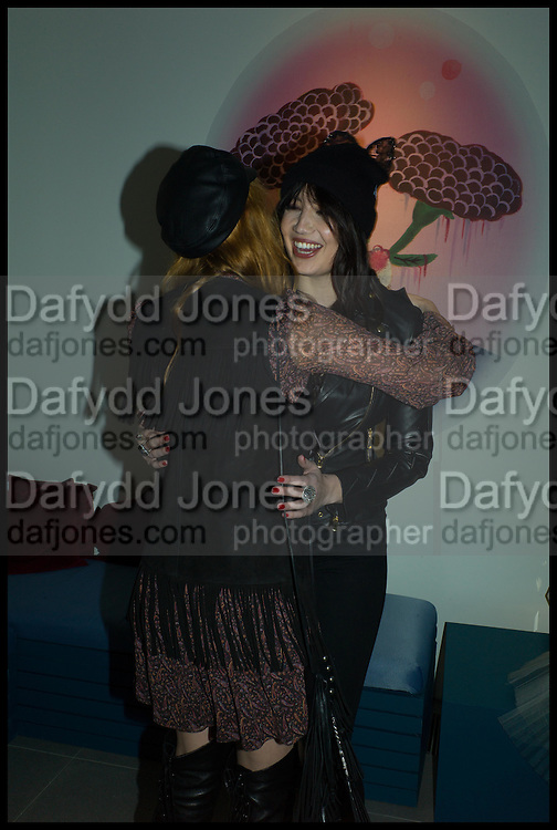 Florence Welch and Daisy Lowe, Julia Peyton-Jones, Hans Ulrich Obrist and Coach host the Serpentine Future Contemporaries Party. Serpentine Sackler Gallery. Kensington Gdns. London. 21 February 2015
