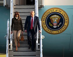 Prestwick Airport, Scotland, UK. 13 July, 2018. President Donald Trump arrives on Air Force One at Prestwick Airport in Ayrshire ahead of a weekend at his golf resort at Trump Turnberry where he is expected to play golf. Donald and Melania Trump exit Air Force One.