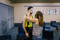 """ROME, ITALY - 27 JUNE 2017: Opera singer Federico Cavarzan has his make-up put on by costume assistant Francesca Ghermandi before his performance of the """"Don Giovanni OperaCamion"""", an open-air opera performed on a truck, at the Aldo Fabrizi library (used as a changing room) in San Basilio, a suburb in Rome, Italy, on June 27th 2017.<br /> <br /> Director Fabio Cherstich's idae of an """"opera truck"""" was conceived as a way of bringing the musical theatre to a new, mixed, non elitist public, and have it perceived as a moment of cultural sharing, intelligent entertainment and no longer as an inaccessible and costly event. The truck becomes a stage that goes from square to square with its orchestra and its company of singers in Rome. <br /> <br /> """"Don Giovanni Opera Camion"""", after """"Don Giovanni"""" by Wolfgang Amadeus Mozart is a new production by the Teatro dell'Opera di Roma, conceived and directed by Fabio Cherstich. Set, videos and costumes by Gianluigi Toccafondo. The Youth Orchestra of the Teatro dell'Opera di Roma is conducted by Carlo Donadio."""