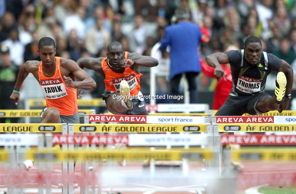 Dexter Faulk,  Ladji Doucoure and Dwight Thomas during the 110 metre hurdle event, at the IAAF Golden League Track and Field meeting on 17 July 2009 in Paris, France. Photo: Panoramic/PHOTOSPORT *** Local Caption ***