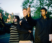 Kayleigh Chris and Kevin with mobile phones, UK, 2000s.