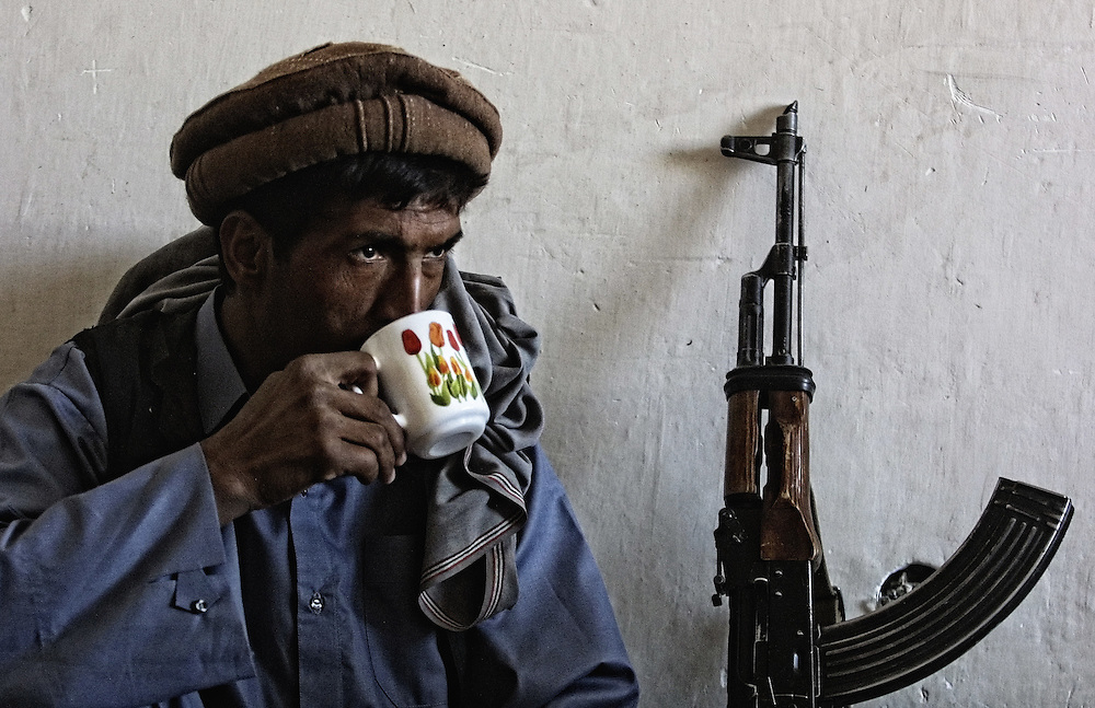 20011009-BAGRAM, AFGHANISTAN: Afghan opposition fighter drinks tea at the Bagram airport, some 30 km from Kabul, 09 October 2001. United States air strikes in Afghanistan continued for a third night today, 09 October 2001.