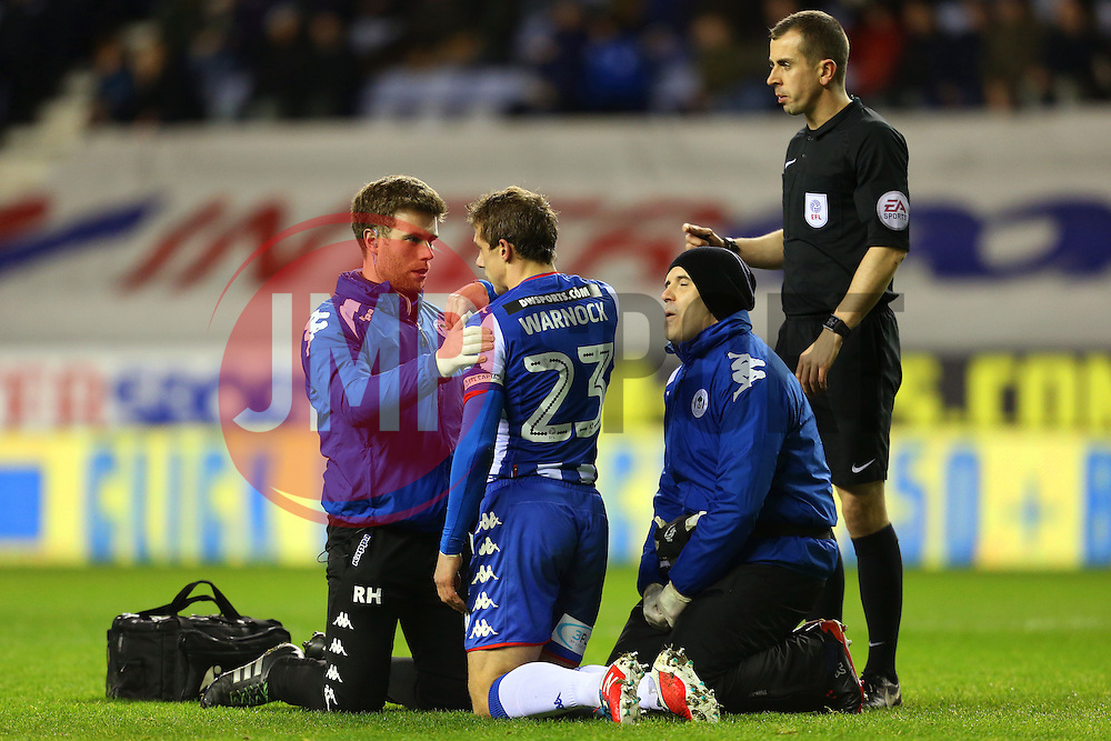 Stephen Warnock of Wigan Athletic receives treatment for a head injury - Mandatory by-line: Matt McNulty/JMP - 07/02/2017 - FOOTBALL - DW Stadium - Wigan, England - Wigan Athletic v Norwich City - Sky Bet Championship