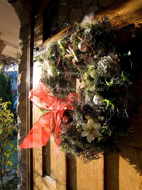 Christmas wreath on wooden front door