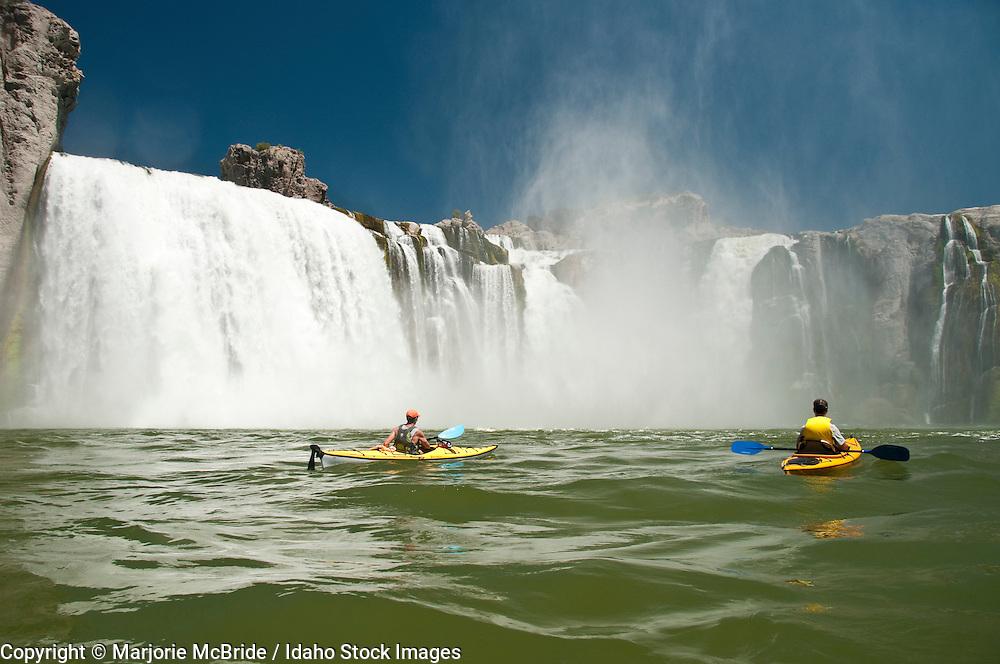 Two men kayaking Shoshone Falls on the Snake River in Twin Falls, Idaho.