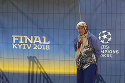 May 23, 2018 - Kiev, Ukraine - An old woman walks past the site of the 2018 UEFA Champions League Final fan zone in central in Kiev, Ukraine, 23 May, 2018. Kiev is preparing for the 2018 UEFA Champions League Final football match between Real Madrid and Liverpool FC next May 26 at the Olimpiyskiy Stadium. (Credit Image: © Str/NurPhoto via ZUMA Press)