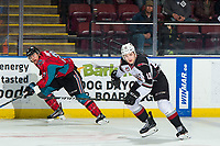 KELOWNA, CANADA - MARCH 16: Leif Mattson #28 of the Kelowna Rockets calls for the puck as Dawson Holt #19 of the Vancouver Giants looks to block the pass on March 16, 2019 at Prospera Place in Kelowna, British Columbia, Canada.  (Photo by Marissa Baecker/Shoot the Breeze)