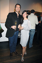 DR TREE RICHARDSON and JAMES SUNDSTAD at a private view of paintings by Lita Cabellut and Russian artist Yuri Kuper at Opera Gallery, 134 New Bond Street, London on 2nd April 2008.<br />