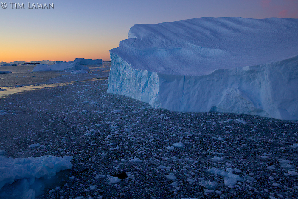 Large iceberg in Cierva Cove, Antarctica, at dusk.