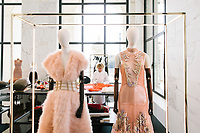 """ROME, ITALY - 15 OCTOBER 2018: A seamstress is seen here working on a FENDI Haute Coutures dress during the LVMH Journées Particulières exhibition at the Fendi headquarters in Rome, Italy, on October 15th 2018.<br /> <br /> The LVMH Journées Particulières is is a series of exhibitions that show the creations and history of the LVMH fashion houses. The driving theme behind the Journées Particulières is to allow the general public to discover the inner workings of the Houses which are part of the LVMH heritage.The LVMH Journées Particulières exhibition by fashion house FENDI takes place at their headquarters at the Palazzo della Civiltà Italiana, also called the """"Colosseo Quadrato"""" (Square Colosseum),  an outstanding jewel of the 20th century Roman architecture."""