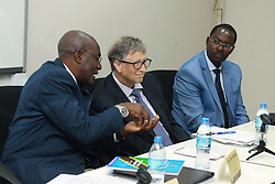 August 10, 2017 - Dar es Salaam, Tanzania - Philanthropist BILL GATES announced a 5 million investment to help digitize Tanzania's health information systems and improve health data in the country. Gates congratulated members of the government of Tanzania on leading a drive to incorporate digital health and data into their policy framework. DR MPOKI, ULISUBISYA, Permanent Secretary, Ministry of Health of Tanzania, left, uses his hands to tell a story to BILL GATES as Hon. GEORGE BONIFACE SIMBACHAWENE, Minister of State in the President's Office, responsible for Regional Administration, Local Government, Civil Service and Good Governance at the Ministry of Health, listens. (Credit Image: © Ric Francis via ZUMA Wire)