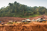 14 MARCH 2013 - BOTEN, LAOS:  Salt works in Boten, Laos, sit in the middle of a construction site that will soon be a parking lot for cars from China. Salt in Boten is made by boiling briny water and collecting the salt that is left behind. The salt wells in Boten, Laos, just south of the Chinese border, have brought a measure of fame to the area for centuries. French forces asserted French dominance over the region in 1894 to control the salt trade. Some of the salt works face an uncertain future because of economic development from China. The area is being developed into a huge parking lot to accommodate truck and tourist traffic into and out of China.PHOTO BY JACK KURTZ